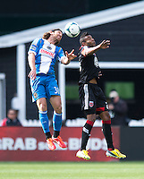 Lionard Pajoy (26) of D.C. United goes up for a header with Jeff Parke (31) of the Philadelphia Union during the game at the RFK Stadium in Washington DC.  Philadelphia defeated D.C. United, 3-2.