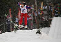 Christian R.  Solberg flies through the air during a ski jumping competition in Lommedalen, outside Oslo.