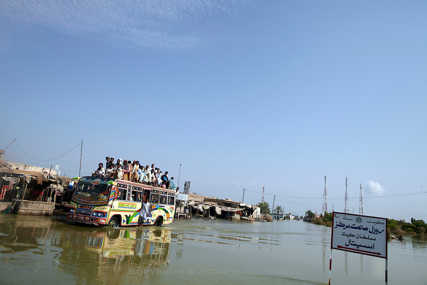 A bus passes through dlood water in the village of Sultan Kot, in Sindh Province, Pakistan.