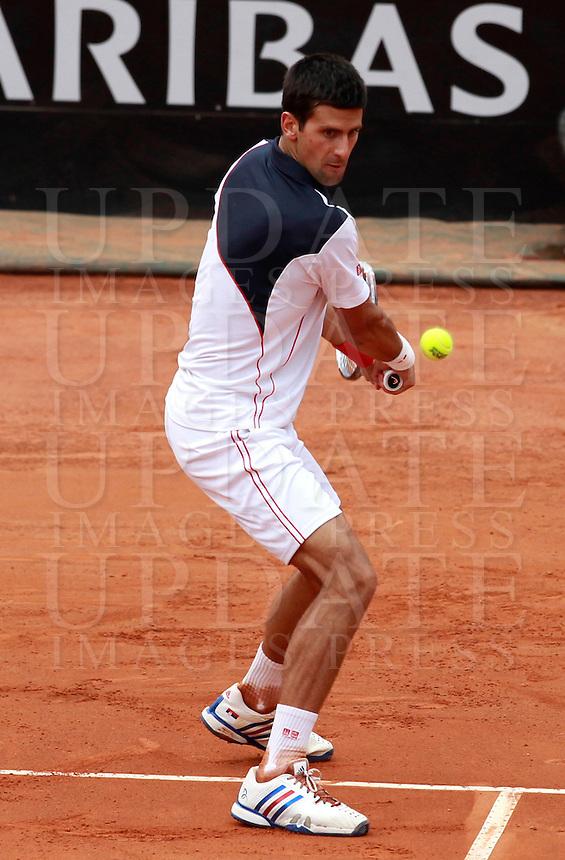Il serbo Novak Djokovic in azione durante la finale maschile degli Internazionali d'Italia di tennis a Roma, 18 maggio 2014.<br /> Serbia's Novak Djokovic in action during the men's final match of the Italian open tennis tournament, in Rome, 18 May 2014.<br /> UPDATE IMAGES PRESS/Isabella Bonotto