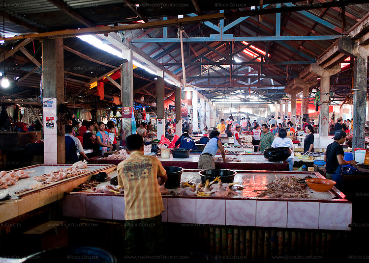The Aertembaga Market (in Bitung, North Sulawesi, Indonesia) is a huge mix of shops and vendors of all types, under a haphazard patchwork of roofing and tarps.  Butchers mix with  farmers and vendors selling goods of all types -- spices, packaged goods, fish, clothing, rice, and just about everything else one can imagine.