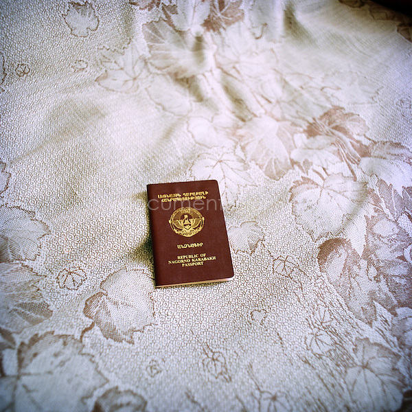 People living in Nagorno-Karabakh have an Armenian passport but some did also get a Karabakh passport in 2006, after that the Constitution has been proclamed. Nevertheless this passport is only symbolic as thet can't go to the polls or travel outside Armenia with  it.