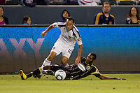 Columbus Crew defender Shaun Francis puts a tackle on LA Galaxy midfielder Landon Donovan. The LA Galaxy defeated the Columbus Crew 3-1 at Home Depot Center stadium in Carson, California on Saturday Sept 11, 2010.