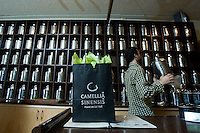 Quebec city, August 1, 2008 - Alexis Risler carries a tea box at the Camellia Sinensis tea house on St-Joseph street in Quebec city.