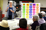 WATERBURY CT. 25 April 2017-042517SV02-Bobbi Kulas runs a Jeopardy game at the Willow/Plaza NRZ Community Center in Waterbury Tuesday.<br /> Steven Valenti Republican-American