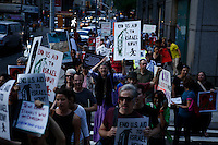New York, USA. 24 July 2014. People march during a protest by Palestine supporters in New York, demanding the end of the war by Israel and Hamas in Gaza. Photo by Eduardo Munoz Alvarez/VIEWpress