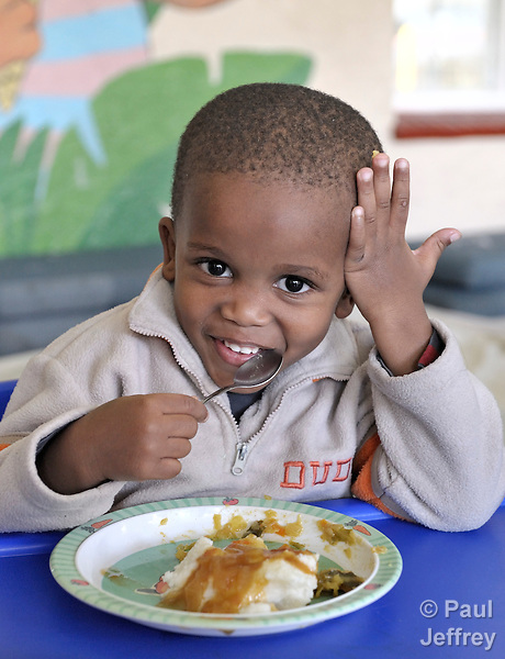 Katlego, an HIV positive child, enjoys a meal in the St. Francis Care Centre's Rainbow Cottage for Babies in Johannesburg, South Africa. The centre is a project of the Roman Catholic Archdiocese of Johannesburg, and is supported by Catholic Relief Services, a member of the Ecumenical Advocacy Alliance.