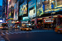 Bright illumination and traffic in Times Square, New York City, USA