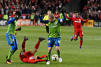 Toronto, ON, Canada - Saturday Dec. 10, 2016: Joevin Jones, Sebastian Giovinco, Osvaldo Alonso during the MLS Cup finals at BMO Field. The Seattle Sounders FC defeated Toronto FC on penalty kicks after playing a scoreless game.