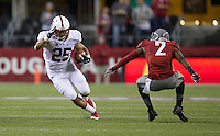 SEATTLE, WA - September 28, 2013: Stanford running back Tyler Gaffney rushes the ball against Washington State's Nolan Washington during play at CenturyLink Field. Stanford won 55-17