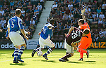 Hearts v St Johnstone...04.08.12.Nigel Hasselbaink fires his shot against the post.Picture by Graeme Hart..Copyright Perthshire Picture Agency.Tel: 01738 623350  Mobile: 07990 594431