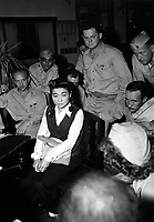 Correspondents interview &quot;Tokyo Rose&quot; Iva Toguri, American-born Japanese.  September 1945.  (Navy)<br /> Exact Date Shot Unknown<br /> NARA FILE #:  080-G-490488<br /> WAR &amp; CONFLICT BOOK #:  1308