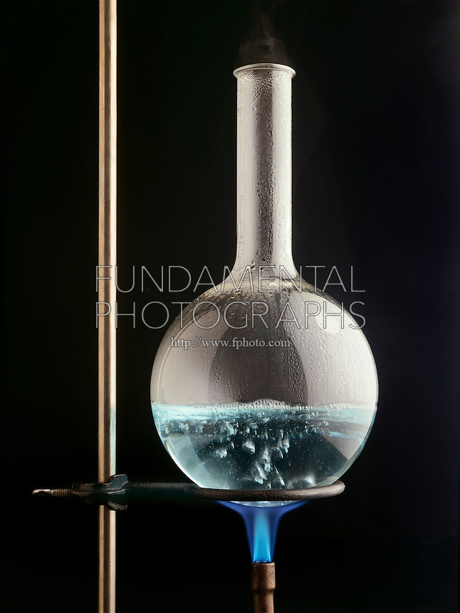 AQUEOUS SOLUTION IN BOILING FLASK (2 of 3)<br /> Propane Flame Heats H2O to Form Steam Bubbles<br /> Shows turbulence of solution at boiling point