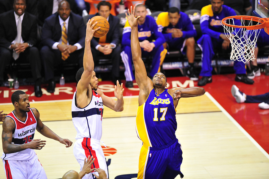 JaVale McGee of the Wizards shoots over Andrew Bynum of the Lakers. Washington defeated Los Angeles 106-101 at the Verizon Center in Washington, D.C. on Wednesday, March 7, 2012. Alan P. Santos/DC Sports Box