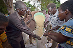 Men pour corn into individual bags during the distribution of food and non-food items to displaced families in Kotobi, South Sudan. The families were displaced by political violence that broke out in December 2013 and quickly fractured regions of the young nation along ethnic and tribal lines. These men are themselves all displaced. Finn Church Aid, a member of the ACT Alliance, provided materials for this aid distribution. The ACT Alliance is providing a variety of services to internally displaced families throughout the country.