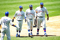 4 May 2011: #16 Aramis Ramierez shakes hands with teammates Carlos Zambrano, Darvin Barney and Marlon Byrd after a home run brought in all three players in the sixth inning.  The Cubs defeated the Dodgers 5-1 during a Major League Baseball game at Dodger Stadium in Los Angeles, California.  Dodgers players are wearing Brooklyn Dodger 1940's throwback jersey uniforms and the Chicago Cubs are also wearing throwback retro jersey uniforms. **Editorial Use Only**