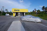 Grand Cayman. Seven Mile Beach. A Porsche 911 at Hertz Rental Car.