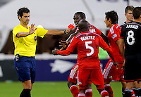 WASHINGTON, D.C - April 26 2014: Referee Fotis Bazakos issues a red card to Michel during the D.C. United vs F.C. Dallas MLS match at RFK Stadium, in Washington D.C. United won 4-1.