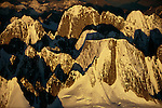 The 11pm light of Alaska's summer illuminates the sheer 2100m (7000ft) cliff faces