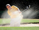 Joe Imel/Daily News.Johnson Central's Tim Miller hits out of the bunker Tuesday at the 2011 Leachman Buick-GMC-Cadillac/KHSAA Boys' State Golf Tournament at Bowling Green Country Club.