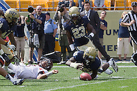 Pitt linebacker Eric Williams (49) recovers a Virginia Tech fumble. The Pitt Panthers defeated the Virginia Tech Hokies 35-17 at Heinz field in Pittsburgh, PA on September 15, 2012.