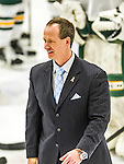 29 December 2014: University of Vermont Catamount Head Coach Kevin Sneddon, in his 12th season coaching the Men's Ice Hockey Team, on the ice to congratulate members of the Providence College Friars after the deciding game of the annual TD Bank-Sheraton Catamount Cup Tournament at Gutterson Fieldhouse in Burlington, Vermont. The Friars shut out the Catamounts 3-0 to win the 2014 Cup. Mandatory Credit: Ed Wolfstein Photo *** RAW (NEF) Image File Available ***