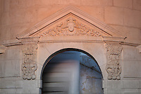 Pediment above the door in the King's Apartment, designed in 1664 under Colbert during the reign of King Louis XIV, on the first floor of the Phare de Cordouan or Cordouan Lighthouse, built 1584-1611 in Renaissance style by Louis de Foix, 1530-1604, French architect, located 7km at sea, near the mouth of the Gironde estuary, Aquitaine, France. This is the oldest lighthouse in France. There are 4 storeys, with keeper apartments and an entrance hall, King's apartments, chapel, secondary lantern and the lantern at the top at 68m. Parabolic lamps and lenses were added in the 18th and 19th centuries. The lighthouse is listed as a historic monument. Picture by Manuel Cohen