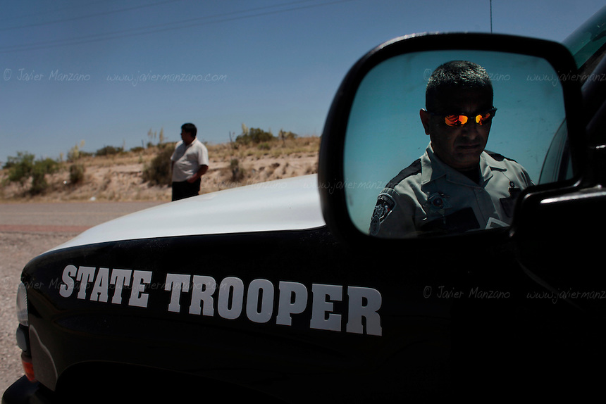 Sergeant Manny Marquez, from the El Paso Sheriff's department realizes a routine search on a transport truck on Interstate Highway 10 on May 24, 2010.
