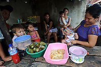 A family-run stall in Tallo, Makassar, Sulawesi, Indonesia.  Large families are the norm in poorer areas such as Tallo.