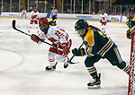 ST CHARLES, MO - MARCH 19:  Mekenzie Steffen (22) of the Wisconsin Badgers and Savannah Harmon (14) of the Clarkson Golden Knights chase after the puck during the Division I Women's Ice Hockey Championship held at The Family Arena on March 19, 2017 in St Charles, Missouri. Clarkson defeated Wisconsin 3-0 to win the national championship. (Photo by Mark Buckner/NCAA Photos via Getty Images)