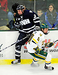 6 December 2009: University of New Hampshire Wildcats' defenseman Connor Hardowa, a Freshman from Edmonton, Alberta, is checked by University of Vermont Catamount forward Colin Vock, a Senior from Detroit, MI, at Gutterson Fieldhouse in Burlington, Vermont. The Wildcats defeated the Catamounts 5-2 in the Hockey East matchup. Mandatory Credit: Ed Wolfstein Photo