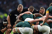 The New Zealand front row of Owen Franks, Dane Coles and Joe Moody prepare to scrummage. Rugby World Cup Semi Final between South Africa and New Zealand on October 24, 2015 at Twickenham Stadium in London, England. Photo by: Patrick Khachfe / Onside Images