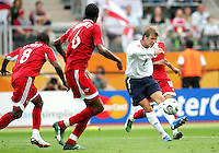 David Beckham of England bends one round the Trinidad wall. England defeated Trinidad & Tobago 2-0 in their FIFA World Cup group B match at Franken-Stadion, Nuremberg, Germany, June 15 2006.