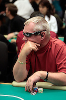 28 February 2009: Poker player wearing Oakley Thump 2 sunglasses that have a MP3 music player ear buds in fashion during the  7th Annual WPT World Poker Tour Invitational at the Commerce Casino in Los Angeles, CA. Players compete for poker glory and a  piece of the $200,000 prize pool. Celebrity and Pro card players in action.