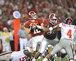 Alabama quarterback Greg McElroy (12) is sacked by Ole Miss defensive tackle Jerrell Powe (57) at Bryant-Denny Stadium in Tuscaloosa, Ala.  on Saturday, October 16, 2010. Alabama won 23-10.
