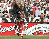 Jordan Graye #16 of D.C. United heads the ball down past Seth Stammler #6 of the New York Red Bulls during an MLS match on May 1 2010, at RFK Stadium in Washington D.C.