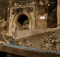 Medina, Tangier, Morocco, pictured on December 27, 2009. Ancient stonewaork is revealed in crumbling walls where a road zigzags up a asteep slope in the Old Town. An ornate archway pierces the wall leading further into the ancient streets of the Medina. Tangier, the 'White City', gateway to North Africa, a port on the Straits of Gibraltar where the Meditaerranean meets the Atlantic is an ancient city where many cultures, Phoenicians, Berbers, Portuguese and Spaniards have all left their mark. With its medina, palace and position overlooking two seas the city is now being developed as a tourist attraction and modern port. Picture by Manuel Cohen