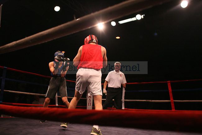 Phi Kappa Psi's Francis Pioquinto fights Sigma Chi's Matt Effinger during the Main Event hosted by Alpha Delta Pi sorority and Sigma Chi fraternity at the Lexington Convention Center on Friday, November 21, 2014. Photo by Taylor Pence | Staff