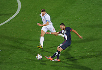 Clint Dempsey (right) of the USA takes a shot which Robert Green (4) of England fumbles and the ball rolls in for a goal. USA vs England in the 2010 FIFA World Cup at Royal Bafokeng Stadium in Rustenburg, South Africa on June 12, 2010.