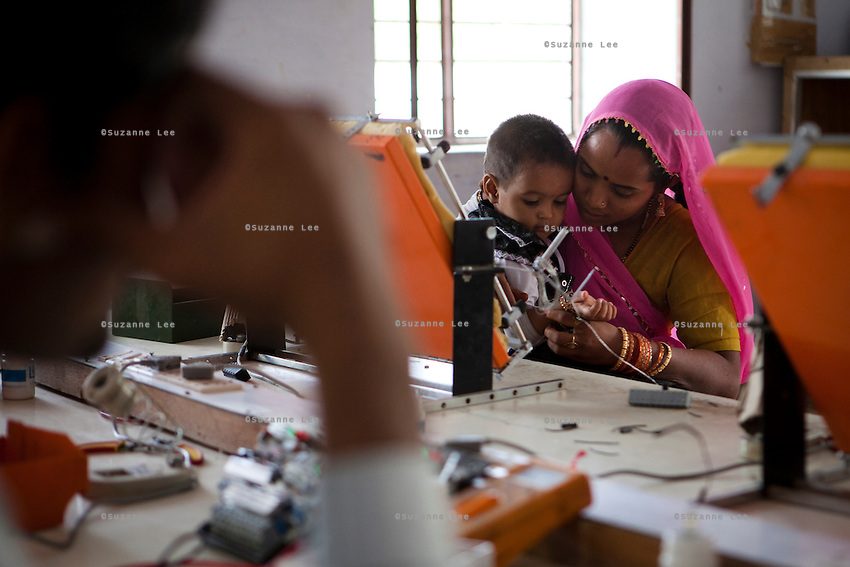 An Indian student studying solar engineering in the Barefoot College in Tilonia village, Ajmer, Rajasthan, India brings her son to school so that she can take care of him and study at the same time. Photo by Suzanne Lee for Panos London
