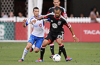D.C. United forward Maicon Santos (29) shields the ball from Montreal Impact midfielder Felipe Martins (7) D.C. United defeated Montreal Impact 3-0 at RFK Stadium, Saturday June 30, 2012.