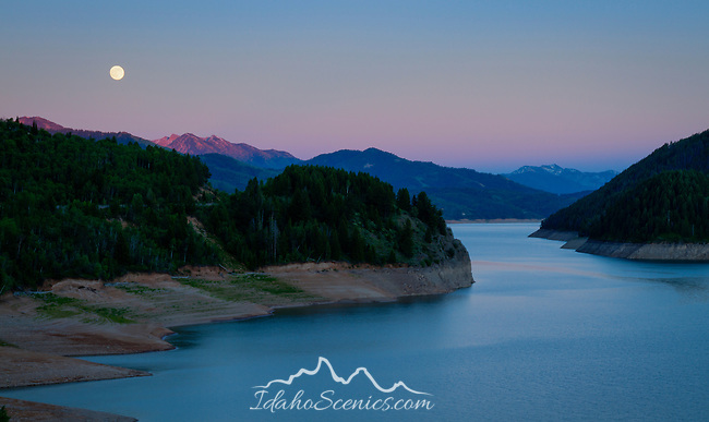 Idaho, Southeastern, Swan Valley. Moon rise over the Palisades reservoir and Salt River Range in early summer.