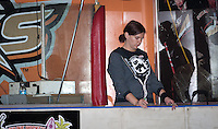 Invader-Grim, one of two Scorekeepers working the bout, checks her math during a break in the action.