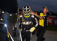 Aug 30, 2014; Clermont, IN, USA; NHRA top fuel dragster driver Tony Schumacher is helped with safety gear by a member of the Safety Safari after winning the Traxxas Shootout during qualifying for the US Nationals at Lucas Oil Raceway. Mandatory Credit: Mark J. Rebilas-USA TODAY Sports