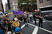 New York, New York<br /> September 30, 2011<br /> <br /> Occupy Wall Street protesters march up Broadway to the Police Headquarters. The police cordon off the area and control protesters as they march from their encampment at Zuccotti Park near Ground Zero and the financial district.<br /> <br /> The participants of the event, that began on September 17,  are mainly protesting against social and economic inequality, corporate greed, and the influence of corporate money and lobbyists on government, among other concerns.<br /> <br /> About 1,000 people have been arrested so far - most on misdemeanor disorderly conduct charges related to blocking traffic or refusing police orders to move.