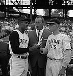 Pittsburgh PA:  Roberto Clemente presenting a trophy to local baseball player from Pleasant Hills before the annual HYPO game at Forbes Field. The money raised by HYPO (Help Young Players Organize) was used to help local communities buy equipment and build ball fields. <br />