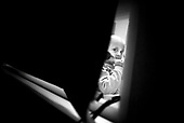 Wroclaw 02.02.2007 Poland.<br /> One of the child in his room.<br /> Clinical Hospital, oncology and haematology departmend. This is one of the important Haematologic Hospital in all over Poland, however hospital board stopped to discharge a rising debt. In this connection authorities must close hospital, but goverment had no idea what should do with terminaly ill children.<br /> (Photo: Adam Lach / Napo Images)<br /> <br /> Akedemicki Szpital Kliniczny, oddzial onkologii i hematologii. Temu jednemu z najwazniejszych w Polsce osrodkowi szpitalnemu grozi zamkniecie w powodu dlugow, ktore niezaleznie od wplat NFZ-tu regularnie sciaga komornik. Z calej Polski ludzie charytatywnie wplacaja pieniadze by uratowac szpital i los dzieci dla ktorych to miejsce jest jedynym ratunkiem.