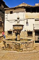 Spain. Pastrana near Guadalajara.  Fountain and square. Castile la Mancha. Model released.