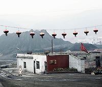 Lanterns hang up next to a building at a coal mining industrial site in Shanxi Province.