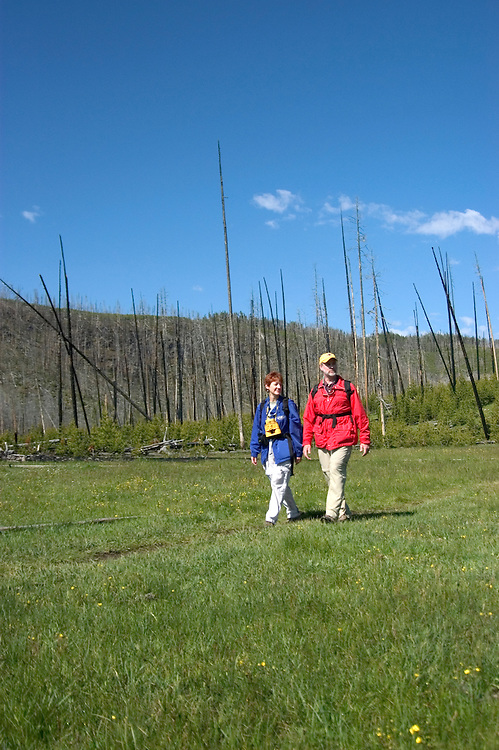 WY: Wyoming; Yellowstone National Park.In Midway Geyser Basin.Couple hiking near Fairy Falls, Model Released.Photo #: yellow1501.Photo copyright Lee Foster, 510/549-2202, lee@fostertravel.com, www.fostertravel.com..